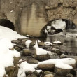 Stock Video: Creek water flow run stone retro architecture arch snow winter