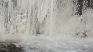 Closeup frozen ice brook river waterfall linn water flow winter — Stock Video