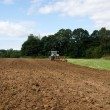Stock Photo: Tractor plowing agricultural field summer