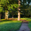Stock Photo: Park path trees morning sun old pagstone altar