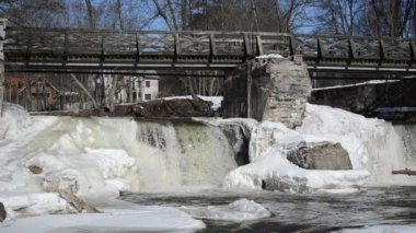 River waterfall cascade retro bridge ice snow icicles winter — Stockvideo