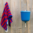 Stock Photo: Rural plastic hand wash tool towel hang wood wall