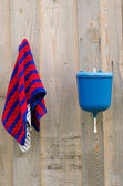 Rural plastic hand wash tool towel hang wood wall — Stock Photo