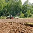 Stock Photo: Tractor plow agriculture field forest summer