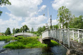 Retro white decorative bridges park stream river — Stock Photo