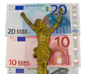 Concept gold jesus crucify euro cash banknotes — Stock Photo