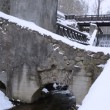 Vintage water mill building creek flow archs stones snow winter — Stock Video #23890903