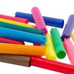 Pile heap colorful felt tip pen cap isolated white — Stock Photo #24053921