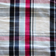 Fabric material square red blue black background - Stock Photo