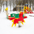 Empty colorful playground surrounded snow winter - Stock Photo