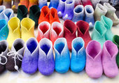 Colorful felt boots in market — Stock Photo