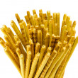 Salty sticks snap beer food closeup isolated white - Photo