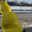 Yellow chairs and floating ice in river in the first days spring — Stock Video