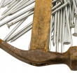 Royalty-Free Stock Photo: Curvy vintage rusty hammer nails pile isolated