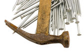 Curvy vintage rusty hammer nails pile isolated — Stock Photo