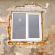 Renovation plastic window old brick house wall — Stock Photo