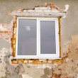 Renovation plastic window old brick house wall — Stock Photo #25254763