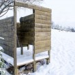 Stock Photo: Wooden planks nailed beach changing booth snow