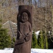 Stock Photo: Rural wooden carved mstatue snow winter park
