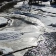 Stock Video: Sun reflections partly frozen river water snow ice winter day