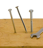 Bend hammered nails board screw bolt wrench white — Stock Photo