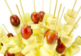 Fruit grape banana scewers stick diet food — Stock Photo