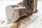 Excavator bucket close sand pit quarry snow winter — Стоковое фото