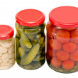 Garlic cucumber tomatoes preserved glass jar pot — Stock Photo
