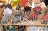 Handmade decorative clay houses fair market event — Stock Photo