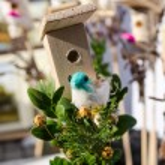 Small bird house handmade bird figure spring fair — Stock Photo #29230281