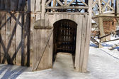 Wooden playground house door cover ice snow winter — Photo