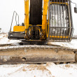 Caterpillar excavator tractor cabin snow winter  — Stock Photo