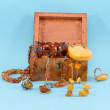 Stock Photo: Amber stone jewelry retro wooden box on blue