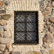 Window iron protect bar retro brick stone house — Stock Photo