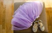 Girl lilac ballerina skirt light gray shiny shoes — Stock Photo