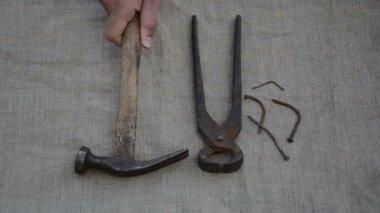 Nails tongs hammer hand — Stock Video