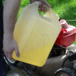 Gardener fill fuel tank — Stock Video