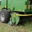 Stock Video: Baler discharge hay bale