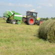 Baler discharge hay bale — Stock Video