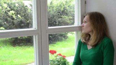 Sad woman window sill — Stock Video
