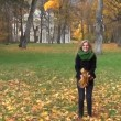 Girl throw leaves autumn — Stock Video #37550307
