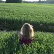 Girl corn field lie — Stock Video #37642159