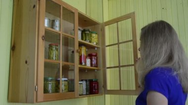 Girl cabinet pickled food — Stock Video