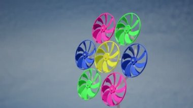 Colorful wind mill spin — Stockvideo