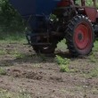 Stock Video: Machine seed sow field