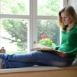 Video Stock: Girl read book sill