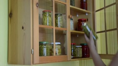 Hand put glass jar food — Stockvideo