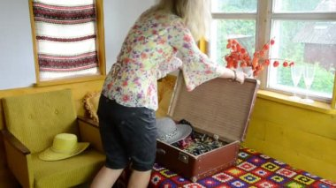 Woman pack cloth suitcase — Stok video
