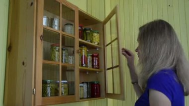 Lady cabinet canned food — Stockvideo