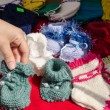 Hand take wool knitted warm cozy baby shoes — Stock Photo #45368199